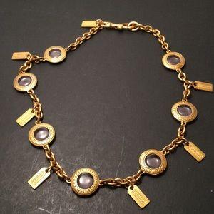 Vintage Coach necklace uses